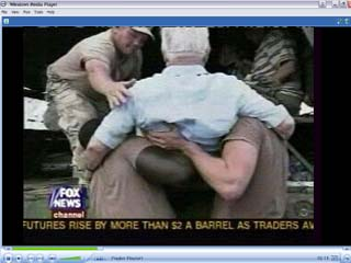 Click image to watch 1.9 mb .wmv video of troops saving lives